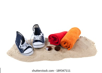 Beach for youth with sand, towels and sunglasses