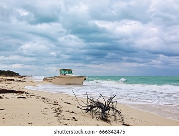 Beached Abandoned Wrecked Fishing Boat under storm cloud skies on Isla Blanca Peninsula Cancun Mexico