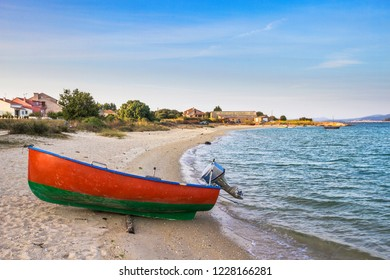 Beached boat at shore of Riason beach in Arousa Island