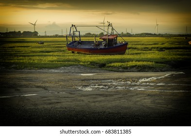 Beached Fishing Boat on Tidal Marsh at Sunderland Point.