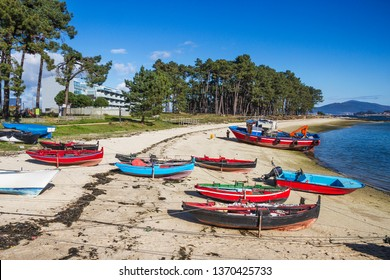 Beached fishing boats on Furado beach, Arousa Island, Galicia, Spain