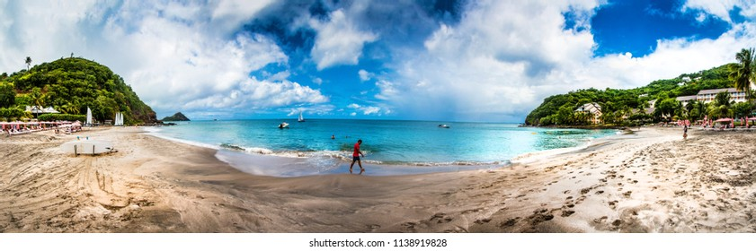 BEACHES, ST LUCIA, WEST INDIES-13th SEPTEMBER 2017:-The beaches in st Lucia, fringed with palm trees, a tropical oasis.