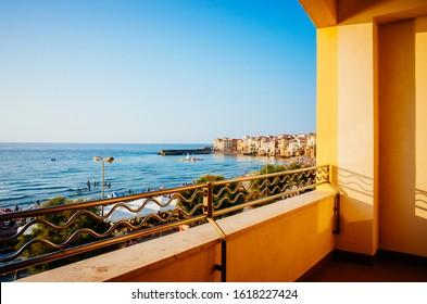Beachfront balcony in Cefalu. Historic Cefalu is a major tourist destination on Sicily.