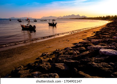 Beachfront overlooks the beautiful sunset and Local fishing boat. Pranburi, Prachuap Khiri Khan, Thailand, It is a beautiful beach surrounded by mountains. And a fishing village.