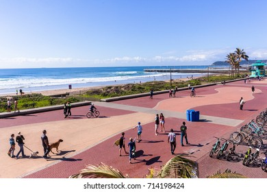 Beachfront Sports Recreation Durban Durban, South-Africa - Aug 20, 2017: Durban beach front promenade ocean waves surfers piers cycling people lifestyle landscape.