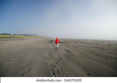 Beachgoer at sand beach in Seaview, Long Beach peninsula, Washington