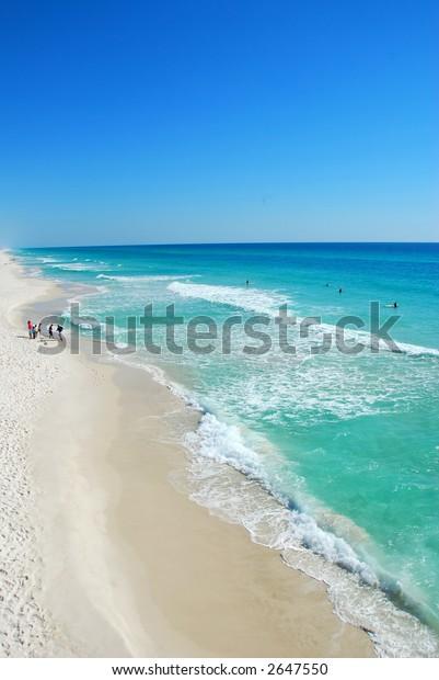 Beachgoers Watching Surfers
