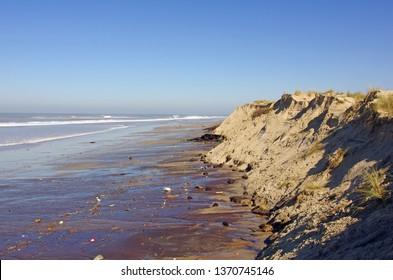 Beachside erosion. Sand dune erosion caused by major storm. Atlantic ocean, France