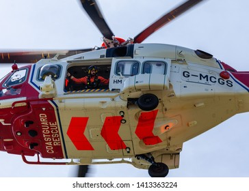 Beachy Head, Sussex, UK. 1st June 2019. Coastguard winchman looks out from open door as helicopter lands