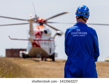 Beachy Head, Sussex, UK. 1st June 2019. Coastguard watches on as HM Coastguard Helicopter lands