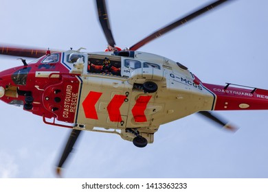 Beachy Head, Sussex, UK. 1st June 2019. Underside shot of HM Coastguard helicopter as it comes into land