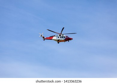 Beachy Head, Sussex, UK. 1st June 2019. Coastguard helicopter G-MCGS hovers above looking for a landing location