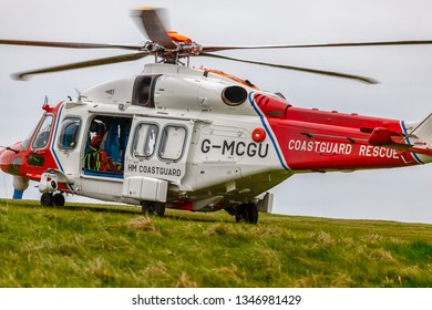Beachy Head, Sussex UK, March 23rd 2019; HM coastguard helicopter and crews were called to Beachy Head today for reports of a body found at the base of the iconic cliffs
