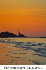 beacon in bibione, italy during sunrise