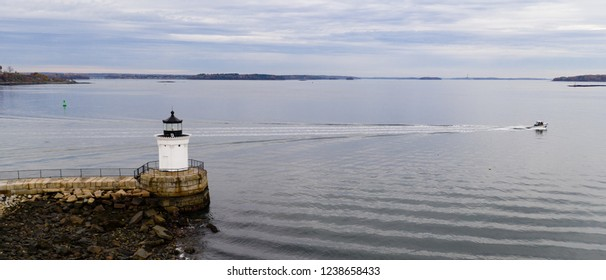 A beacon in Portland harbor warns mariners of dangerous rocks and surf on the Atlantic Ocean East Coast