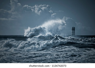 Beacon and south pier of Douro river mouth under heavy storm with big waves. Used infrared filter. Toned blue.