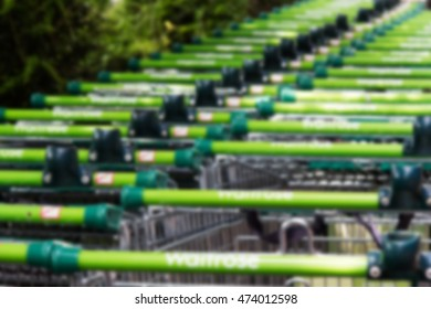 BEACONSFIELD, ENGLAND - JUNE 2016: Waitrose shopping trollies outside store in Beaconsfield Out of focus.