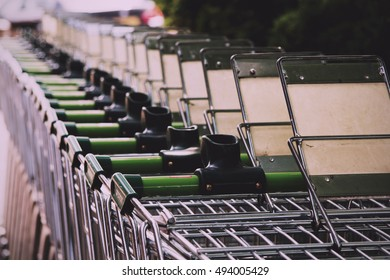 BEACONSFIELD, ENGLAND - JUNE 2016: Waitrose shopping trollies outside store in Beaconsfield Vintage Retro Filter.