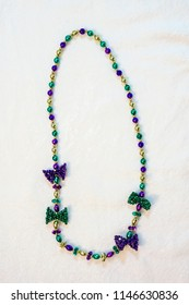 bead mardi gras  fat tuesday carnivale  holiday shiny colors