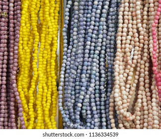 Bead necklaces on display.
