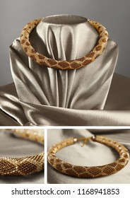 Bead rope, seed beads, bead necklace. Black bead necklace on a old gold satin on gray background
