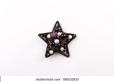 A beaded brooch in the shape of a star