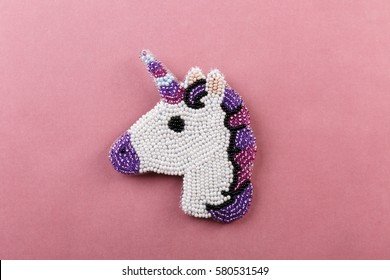 A beaded brooch in the shape of a unicorn