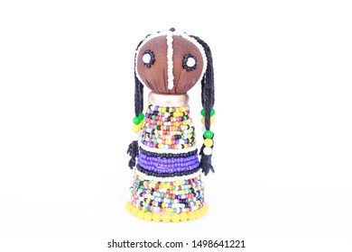 Beaded colorful African Ndebele doll isolated on a white background