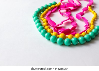beaded necklace from colorful beads in the white background