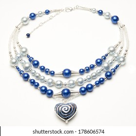 Beaded necklace with heart pendant