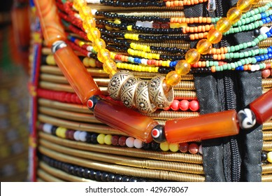 Beads and coiled brass worn by female Rungus of Sabah, Borneo, Malaysia on the hip as wedding ceremony costume. Other than beautiful, beads of Borneo hold social, economic and cultural meaning.