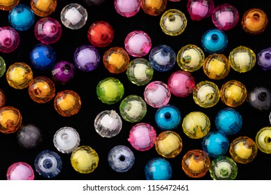 Beads, colorful beads on a black background,