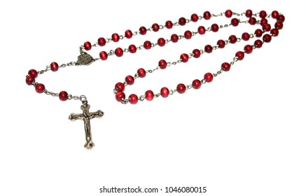 beads of mahogany beads and a metal crucifix on a white background
