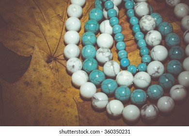 Beads with natural stone blue and white turquoise close up filtered colors.