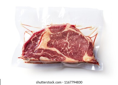 Beaf steak vacuum sealed ready for sous vide cooking isolated on white background, top view