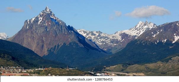 The Beagle Channel Patagonia Argentina develops between several islands; to the north lies Argentine-Chilean Isla Grande de Tierra del Fuego, to the south Hoste, Navarino, and Picton and Nueva.