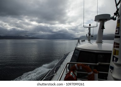 The Beagle Channel in Patagonia, Argentina as seen from a sailboat on a dramatic gloomy day