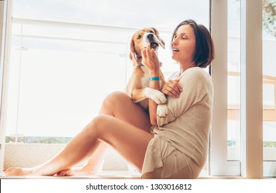 Beagle dog and its owner on sunny terrace