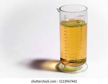 Beaker or flask with yellow liquid isolated on white background