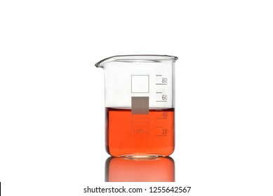 Beaker with red liquid on white background