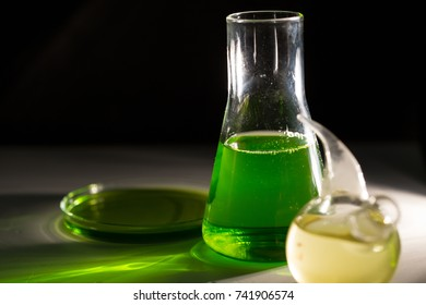 Beaker and retort with green and blue with a chemical reagent. Chemical experiment with Laboratory glass