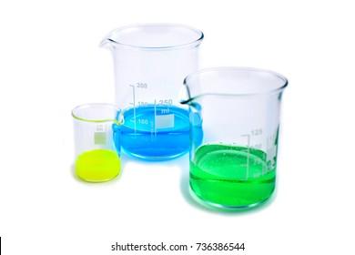 Beaker stock images. Glass Measuring Beaker. Laboratory beaker on a white background. Beaker with colored liquid