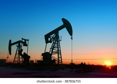 The beam pumping unit is homework, sunset in oil field