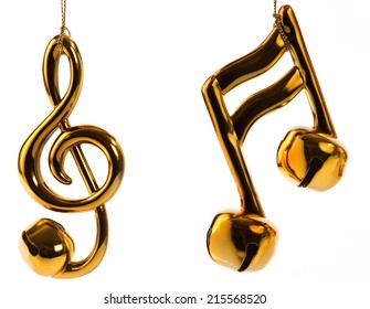 Beamed sixteenth note, and treble clef jingle bell Christmas ornaments isolated on white background.