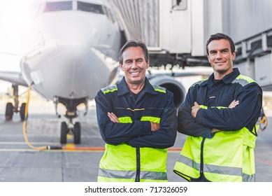 Beaming workers having job at airdrome