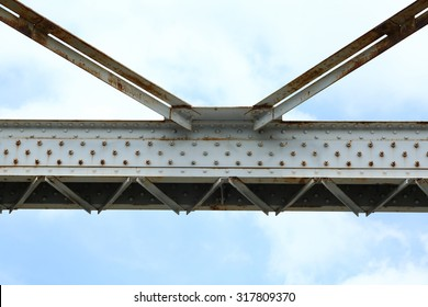 Beams of the bridge on a background of the blue sky