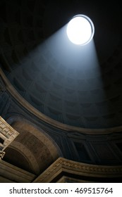 Beams of light entering the Pantheon from the dome's oculus. Rome, Italy.