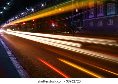 Beams of light made by city traffic in the night