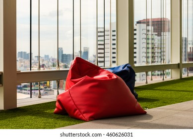 Bean bag on artificial grass in relax zone , office building