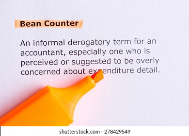 bean counter   word highlighted  on the white paper